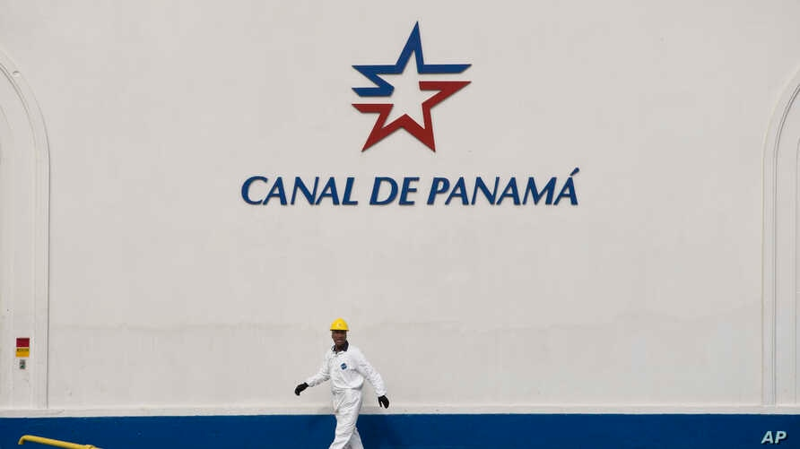 A worker walks next to the Miraflores Locks during a press tour of the Panama Canal in Panama City, June 25, 2016. The $5.25 billion expansion of the Panama canal is set to open Sunday.