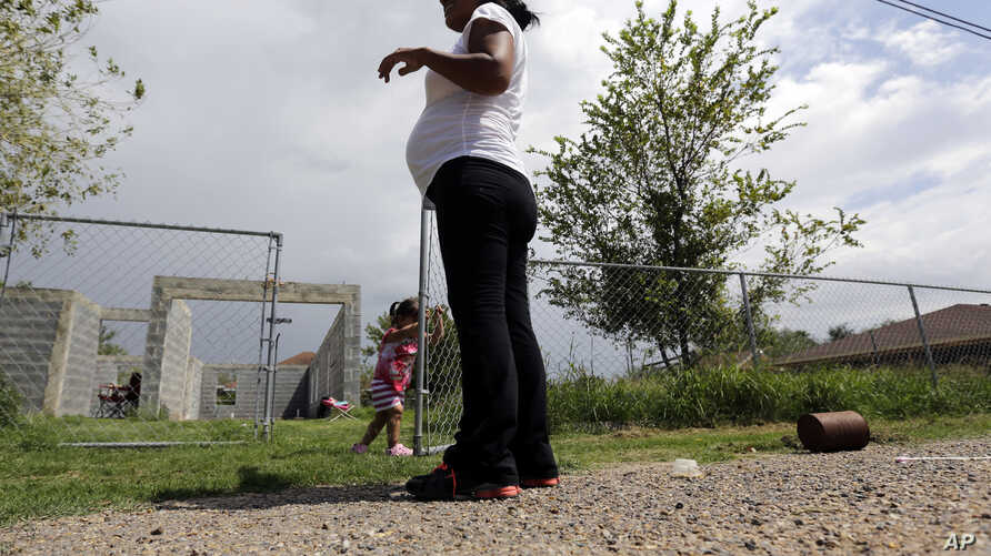 Birthright Citizenship TexasFILE - A woman  who said she entered the United States illegally, watches over her daughter who was born in the U.S., in Sullivan City, Texas, Sept. 16, 2015.