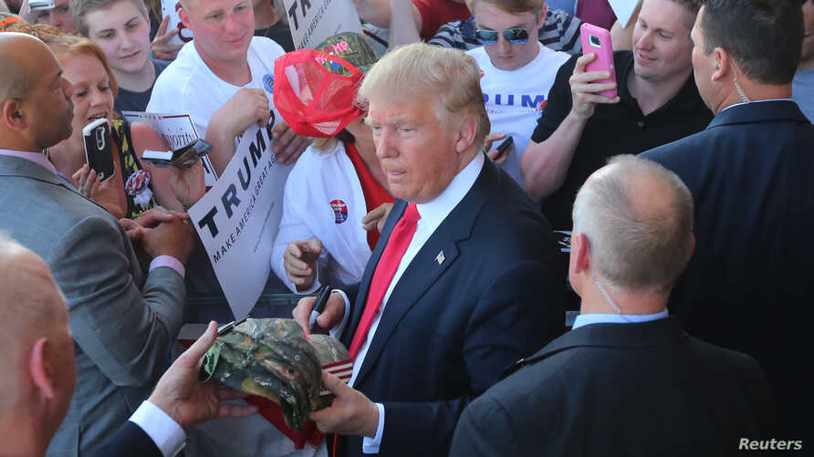 US Republican presidential candidate Donald Trump greets supporters at his campaign rally at Werner Enterprises Hangar in Omaha, Nebraska, US May 6, 2016.