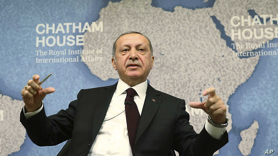 """Turkey's President Recep Tayyip Erdogan speaks at Chatham House in London, May 14, 2018. Erdogan started Sunday a three-day visit to Britain by praising the country as """"an ally and a strategic partner, but also a real friend."""""""