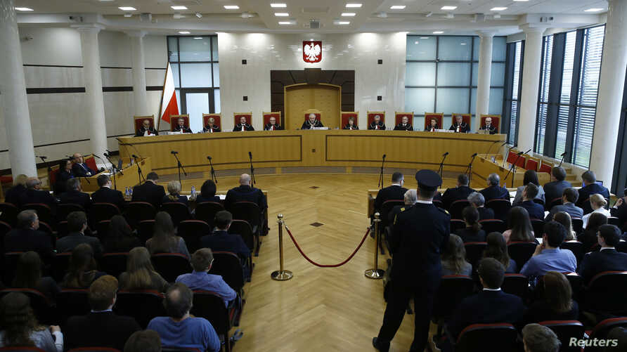 FILE - Judges of Poland's Constitutional Court attend a session at the Constitutional Tribunal in Warsaw.