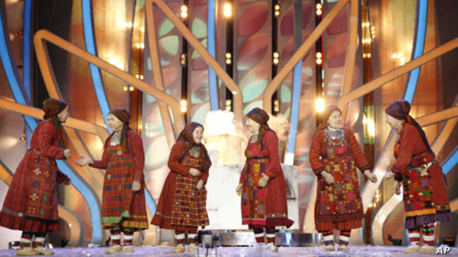 A Russian group known as the Buranovo Grannies, pose after winning a song contest in Moscow and the right to represent the country at this year's Eurovision Song Contest, March 7, 2012.