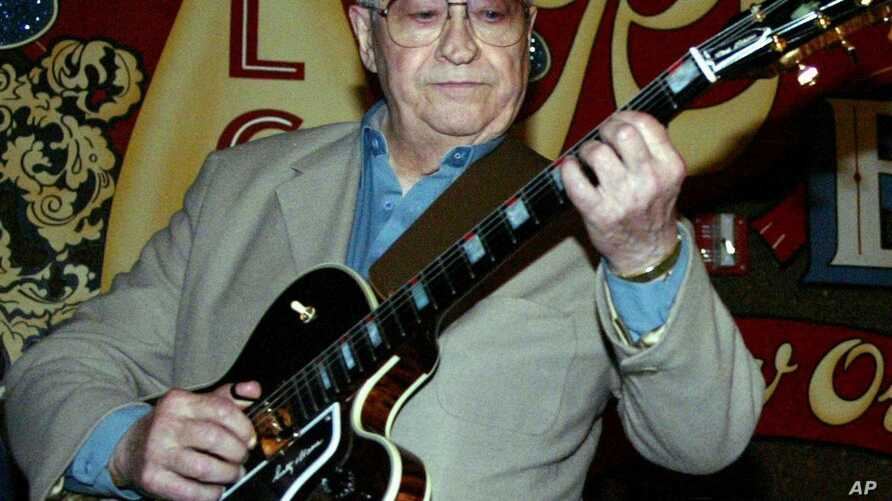 FILE - Scotty Moore, a former guitarist for Elvis Presley, playing music at the 2nd annual Ponderosa Stomp in New Orleans.