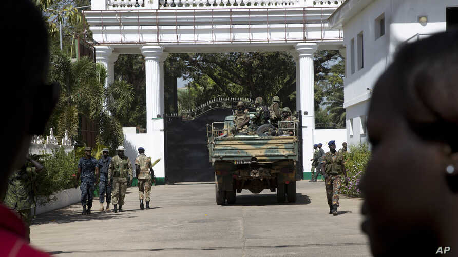 Senegalese troops enter the State House in Banjul, Gambia, Jan. 23, 2017, two days after Gambia's defeated leader Yahya Jammeh left the country. Troops of  Economic Community of West African States  have moved into the State House to prepare for the