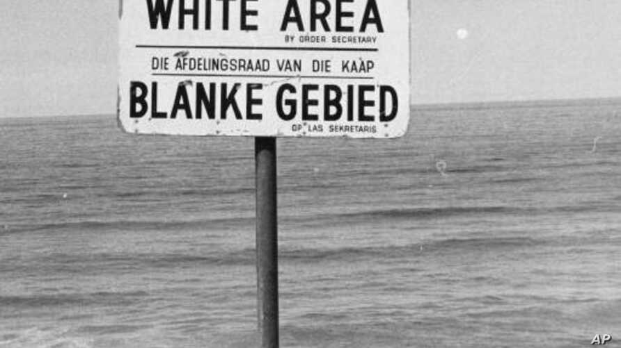 During Apartheid blacks and mixed race people were excluded from many places, for example, at the bayside like indicated on this sign-post. (06/23/76)(AP PHOTO)
