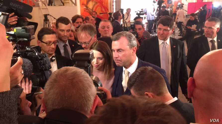 Far right candidate Norbert Hofer speaks to reporters after his defeat in Austria's presidential election, Dec. 4, 2016. (L. Ramirez/VIA).