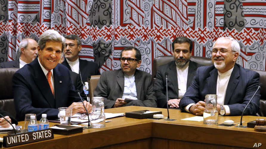 U.S. Secretary of State John Kerry and Iranian Foreign Minister Mohammad Javad Zarif attend a meeting of the five permanent members of the Security Council plus Germany during the 68th session of the United Nations General Assembly at U.N. headquarte