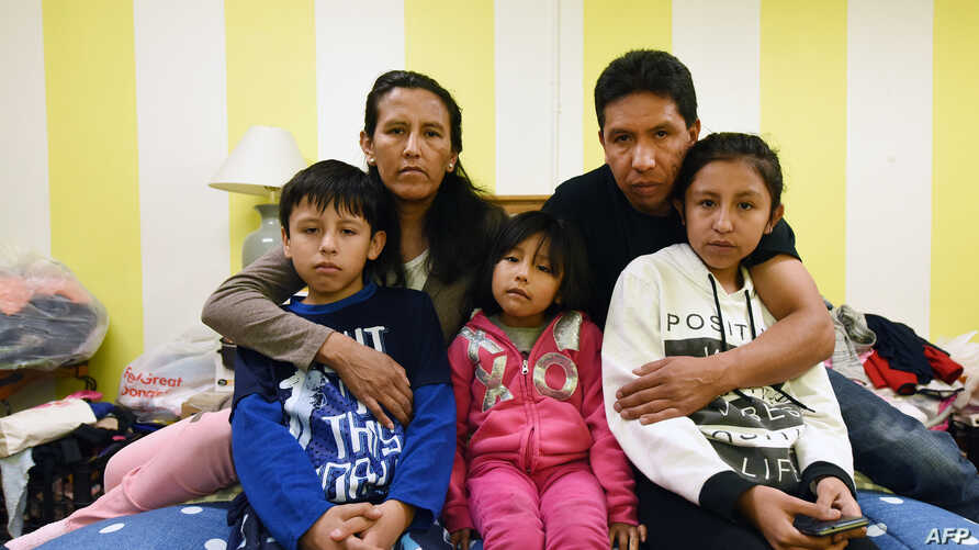 FILE - Jeanette Vizguerra (2-L) poses with her husband Salvador Baez (2n-R) and their children, in the First Unitarian Society Church of Denver, in Denver, Colorado on Feb. 16, 2017. The family, undocumented immigrants, had taken refuge in the church