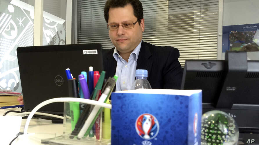 Ziad Khoury, the security director for the Euro 2016 soccer championships, works in his office after responding to questions during an AP interview, May 17, 2016, in Paris. Khoury said anti-drone technology would be deployed over stadiums as part of
