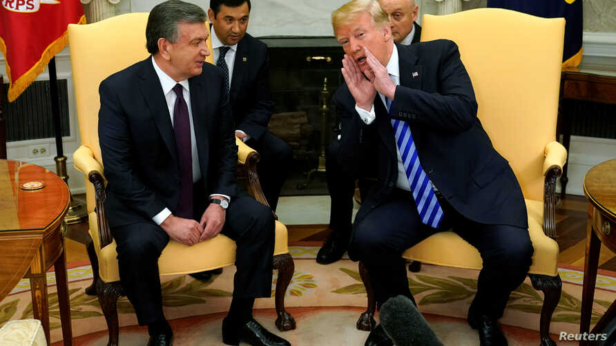 FILE - President Trump and Uzbekistan President Shavkat Mirziyoyev meet at the White House, May 16, 2018.