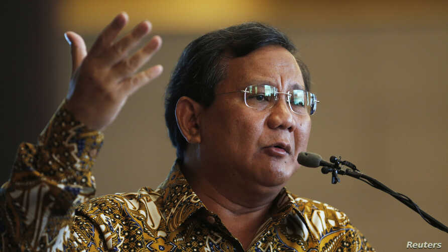 FILE - Indonesian presidential candidate Prabowo Subianto of the Gerindra party gestures during a speech to members of the Jakarta Foreign Correspondents Club, in Jakarta.