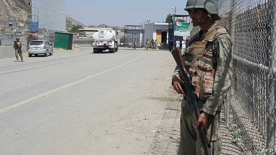 Pakistani soldiers patrol at the Torkham border crossing between Pakistan and Afghanistan in Pakistan's Khyber Pass on June 14, 2016. Both sides are blaming each other for a recent spike in tensions at the frontier.