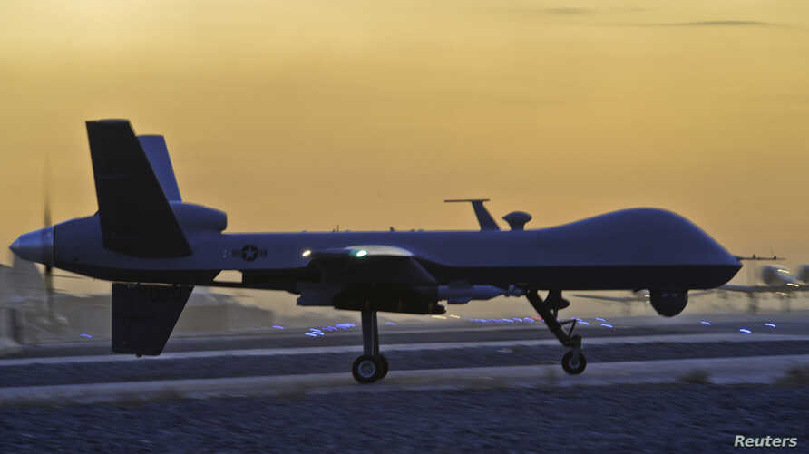 FILE - A MQ-9 Reaper drone taxis at Kandahar Airfield, Afghanistan in this Dec. 27, 2009 photo. The U.S. State Department has approved a longstanding request from Italy to arm its two MQ-9 Reaper drones with Hellfire missiles, laser-guided bombs and