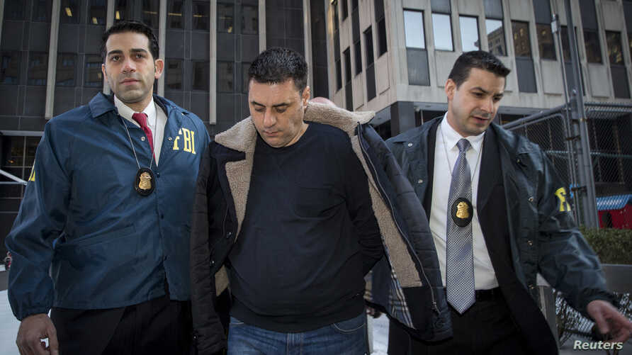 Gambino family associate Franco Lupoi is escorted by FBI agents from their Manhattan offices in New York Feb 11, 2014.