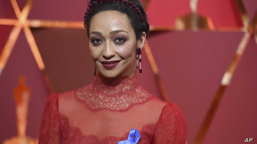 Ruth Negga, wearing the ACLU ribbon, arrives at the Oscars on Sunday, Feb. 26, 2017, at the Dolby Theatre in Los Angeles.