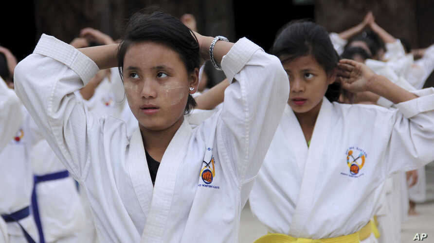FILE - 16-year-old Hkawn Ra, joins the karate training for self-defense in Je Yang village IDP camp, near China border in Kachin State, Myanmar, Nov. 29, 2016.