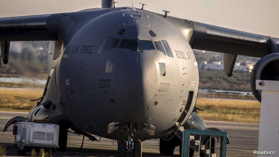 A Royal Air Force (RAF) C17 plane is seen on the tarmac ready to transport British tourists, who were wounded during the Imperial Marhaba hotel attack by a gunman, in Monastir airport, Tunisia, June 29, 2015.