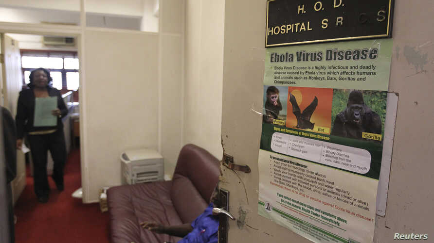A poster providing information on the Ebola virus is picture on the door of the Head of Department of Hospital Services, at the Federal Ministry of Health in Abuja, Aug. 11, 2014.
