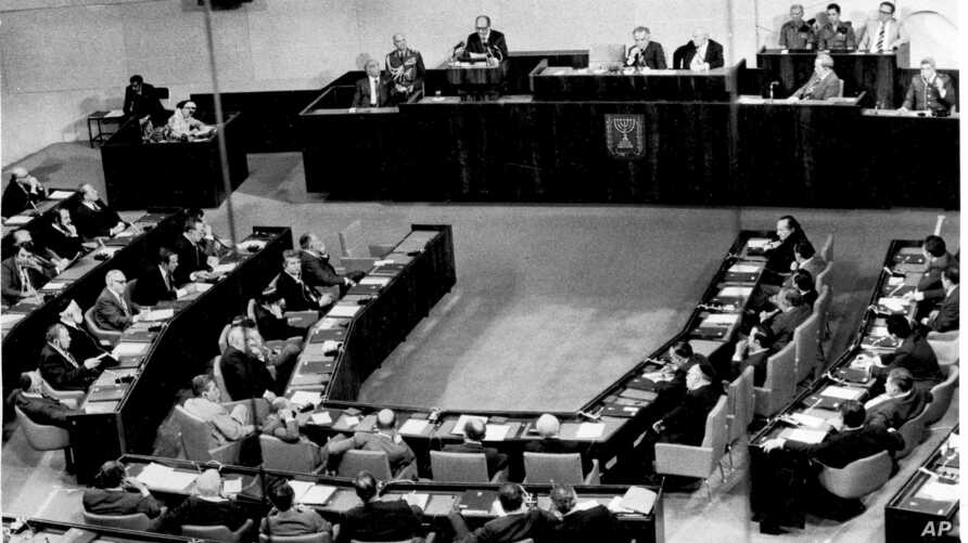 FILE - Egyptian President Anwar Sadat is seen at the speaker's podium during his address to lawmakers in Israel's parliament, in Jerusalem, Nov. 20, 1977.