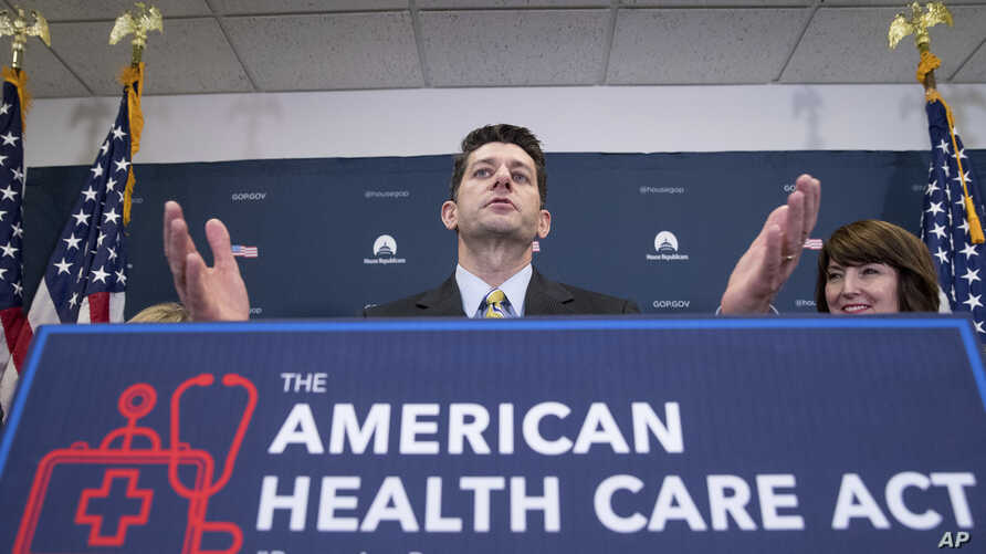 House Speaker Paul Ryan of Wisconsin, accompanied by Rep. Cathy McMorris Rodgers, R-Wash., right, speaks at a news conference following a GOP party conference at the Capitol in Washington, March 15, 2017.