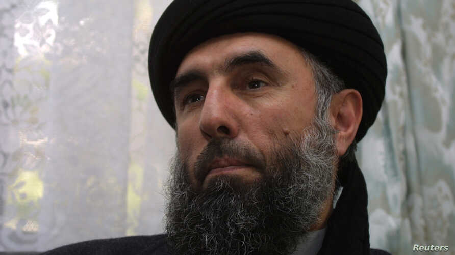 FILE - Gulbuddin Hekmatyar speaks to a reporter in 2002.