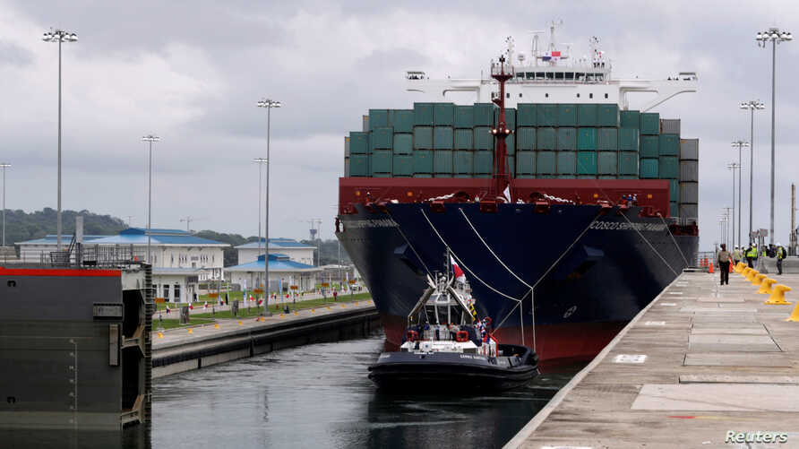 A floating gate is opening to the Chinese COSCO container vessel named Andronikos navigating through the Agua Clara locks during the first ceremonial pass through the newly expanded Panama Canal in Agua Clara, on the outskirts of Colon City, Panama J...