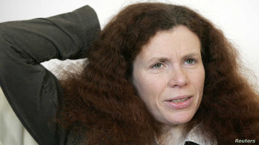 FILE - Russian journalist Yulia Latynina speaks during an interview with Reuters in Moscow, Feb. 25, 2009.