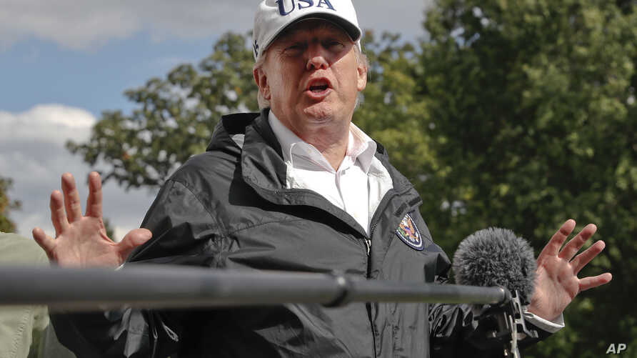 President Donald Trump answers a question from the media as he arrives at the White House, Sept. 14, 2017, in Washington.