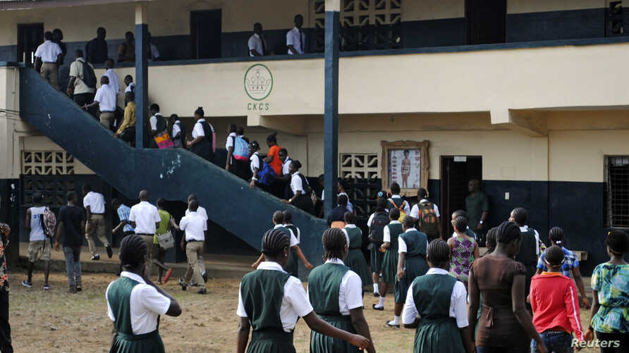 Thousands of Liberian children in pristine uniforms flocked back to school on Monday as classrooms opened their doors for the first time after a six-month hiatus designed to stem the spread of the worst Ebola outbreak in history, Feb. 16, 2015.