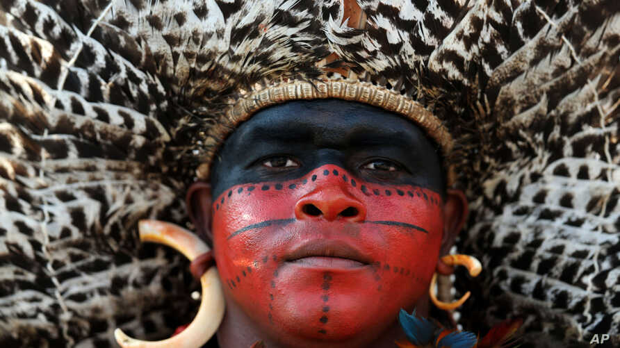 A Pataxo Indian, of Brazil, attends the World Indigenous Games in Palmas, Brazil, Oct. 29, 2015.
