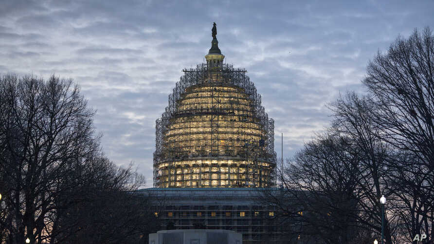 The Capitol Dome in Washington is illuminated early on Jan. 12, 2016, the day of President Barack Obama's final State of the Union address before Congress in Washington.