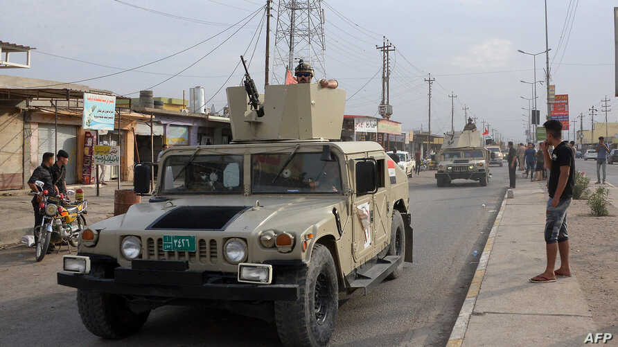 An Iraqi army vehicle patrols after a car bomb attack on Oct. 23, 2018 killed six people and wounded 26 more at a market in Al Qayyarah, located south of the Islamic State group's former Iraqi capital of Mosul.