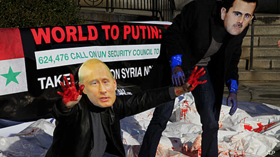 Members of the citizens action and human rights group Avaaz stage a protest with fake blood, body bags and wearing the mask of Syrian leader Bashar al-Assad and Russia's Vladimir Putin outside the United Nations, January 24, 2012.