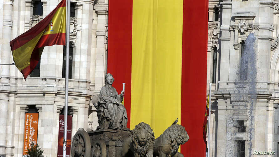 Spanish flags are displayed at Madrid's Town Hall, June 18, 2014.