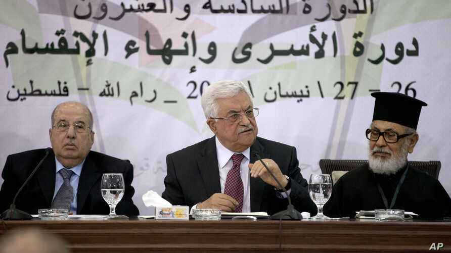 Palestinian President Mahmoud Abbas, middle, speaks during a meeting with the Palestinian Central Council, a top decision-making body, at his headquarters in the West Bank city of Ramallah, April 26, 2014.