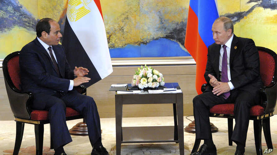 Russian President Vladimir Putin, right, and Egyptian President Abdel-Fattah el-Sissi hold a  bilateral meeting on the sidelines of the BRICS Summit in Xiamen, Fujian province, China, Monday, Sept. 4, 2017.