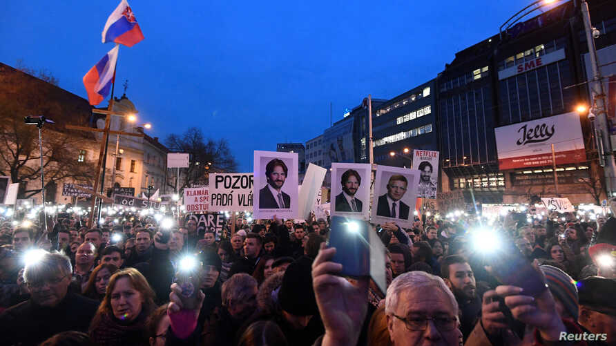 """Demonstrators attend a protest called """"Let's stand for decency in Slovakia"""" in reaction to the murder of Slovak investigative reporter Jan Kuciak and his fiancee, Martina Kusnirova, in Bratislava, Slovakia, March 9, 2018."""