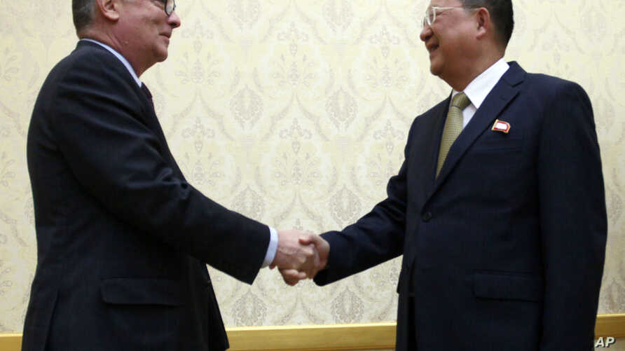 North Korean Foreign Minister Ri Yong Ho, right, and U.N. undersecretary-general for political affairs Jeffrey Feltman shake hands at the Mansudae Assembly Hall in Pyongyang, North Korea, Dec. 7, 2017. The senior United Nations official is on a four-