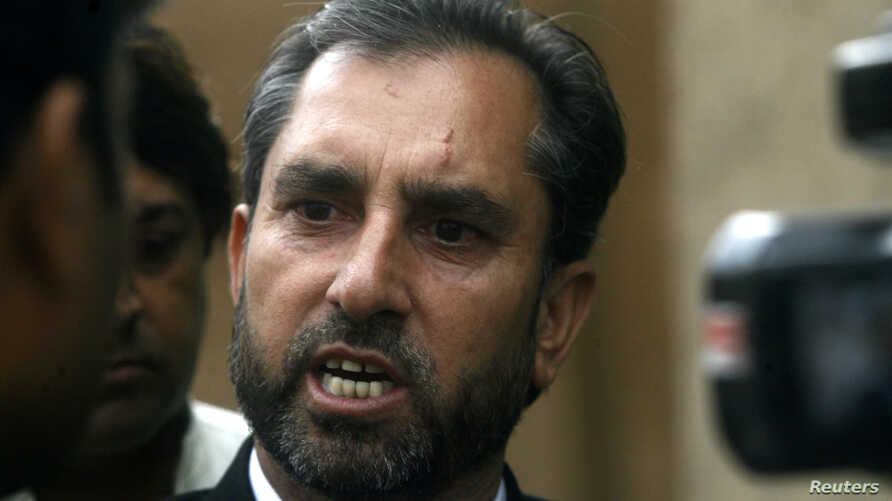 FILE - Samiullah Afridi, lawyer for Shakil Afridi who ran a fake vaccination campaign to try help U.S. officials find al-Qaida chief Osama bin laden, speaks after appearing before the court in Peshawar.