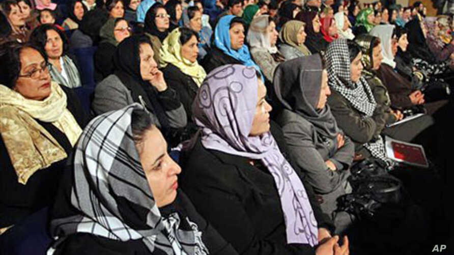 Afghan women listen to Afghan President Hamid Karzai, during a speech about women's rights in Kabul (File)