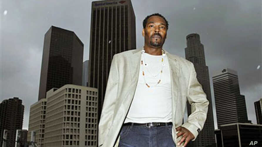 Rodney King poses for a portrait in Los Angeles, April 13, 2012. The acquittal of four police officers in the videotaped beating of King sparked rioting that spread across the city and into neighboring suburbs, leaving cars demolished, homes and busi