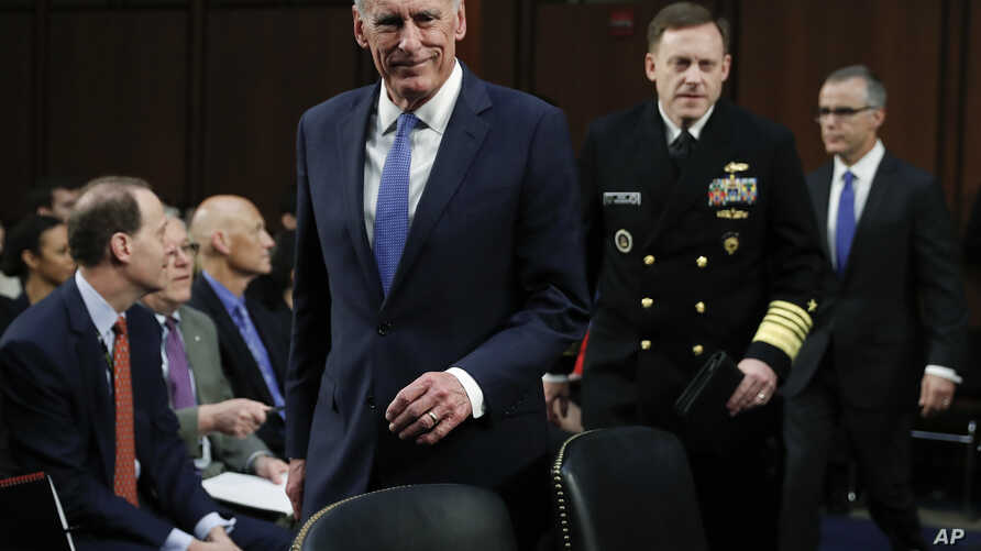 From left, National Intelligence Director Dan Coats, National Security Agency director Adm. Michael Rogers and acting FBI Director Andrew McCabe, arrive for the Senate Intelligence Committee hearing about the Foreign Intelligence Surveillance Act, on...