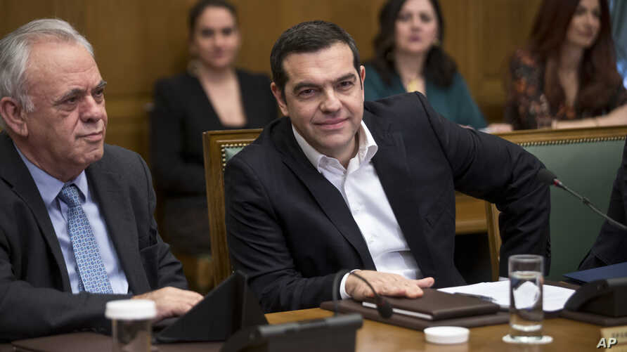 Greek Prime Minister Alexis Tsipras, right and ministers of his government attend a cabinet meeting in the parliament in Athens, Jan. 28, 2019.