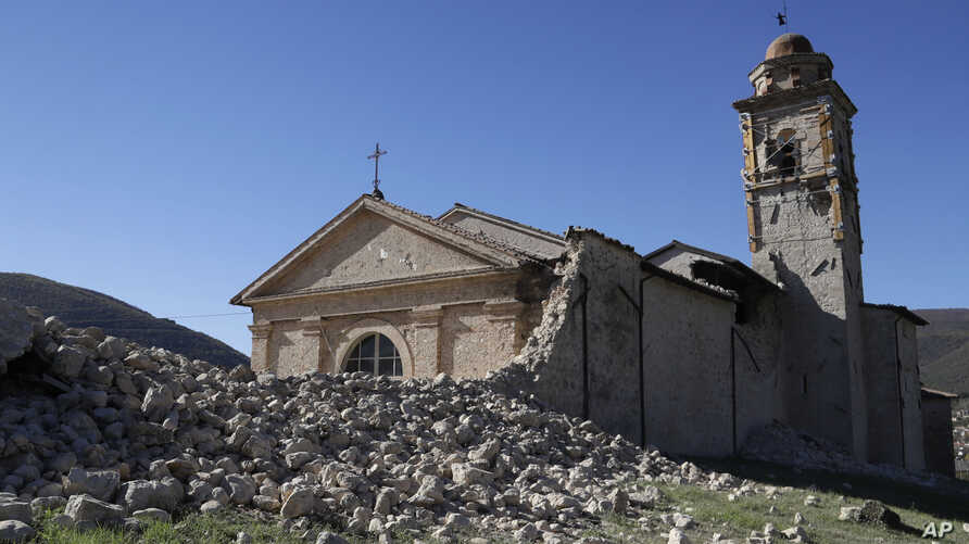 The tower of the Church of the Madonna of the Angels (Madonna degli Angeli) is still standing amidst rubble near Norcia, central Italy, after an earthquake with a preliminary magnitude of 6.6 struck central Italy, Oct. 30, 2016.