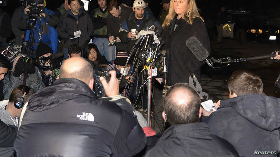 San Bernardino County sheriff's spokeswoman Cindy Bachman (top R) briefs the media at a news conference after a standoff and shootout with former LAPD officer Christopher Dorner, in the town of Angelus Oaks, California, Feb. 12, 2013.