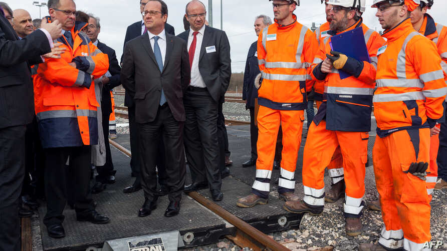 French President Francois Hollande attends the inauguration of the new Sud Europe Atlantique (South Europe Atlantic) high-speed rail line, linking Tours and Bordeaux, on Feb. 28, 2017, in Villognon, central France.