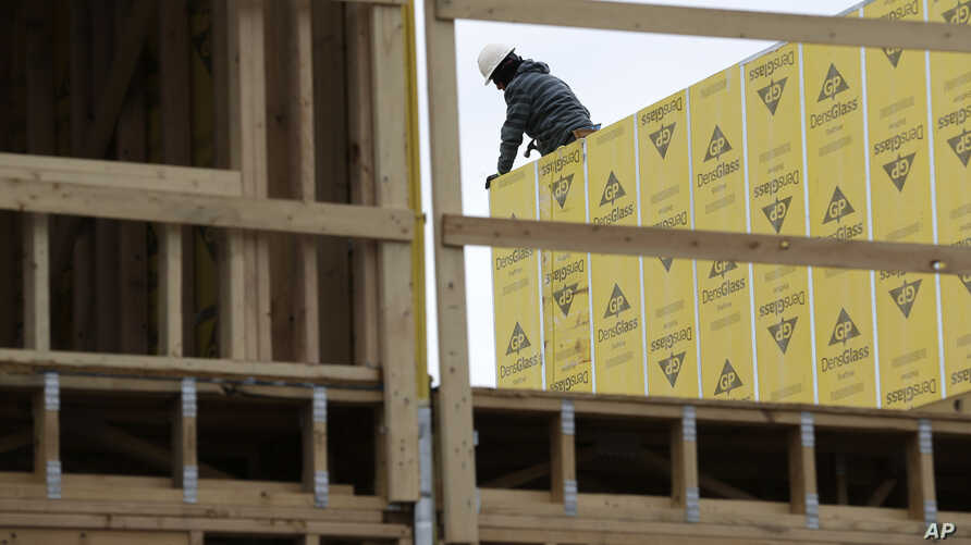 FILE- Work continues on a new development in Fair Lawn, New Jersey, Feb. 26, 2018. On March 9, the Labor Department reported that U.S. employers added 313,000 jobs in February, the most in any month since July 2016.