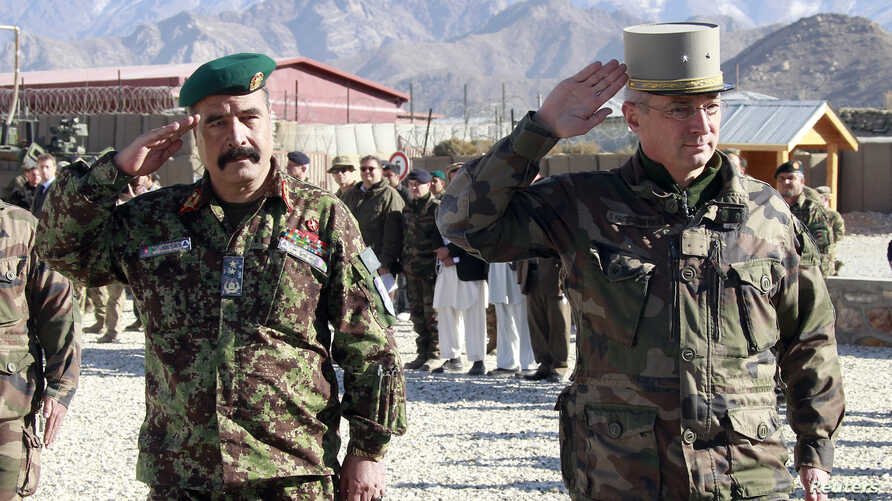 French General Eric Hautecloque Raysz (R) and his Afghan counterpart General Mohammad Zaman Waziri salute during handover ceremony, Nov 20, 2012.