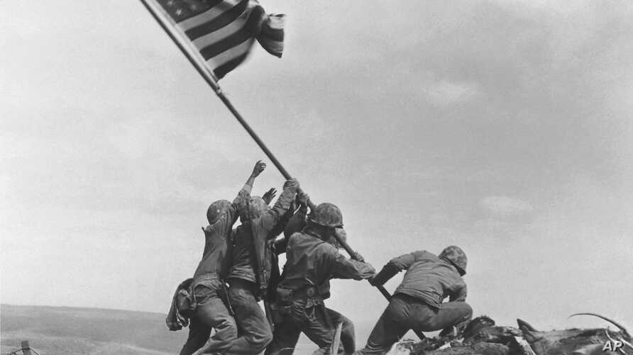 FILE - U.S. Marines raise the American flag atop Mount Suribachi, Iwo Jima, Japan, Feb. 23, 1945. The Marines Corps said Thursday that Private First Class Harold Schultz of Detroit was in the photo and that Navy Pharmacist's Mate 2nd Class John Bradl