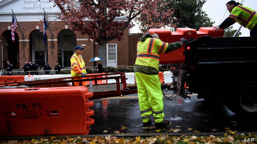 City workers place barricades around the court grounds during the first day of jury selection for the James Fields murder trial at Charlottesville Circuit Court in Charlottesville, Virginia, Nov. 26, 2018.